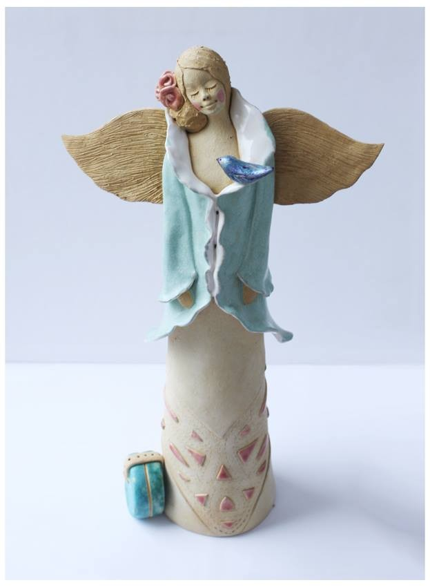 Anioł podróżny z kuferkiem
