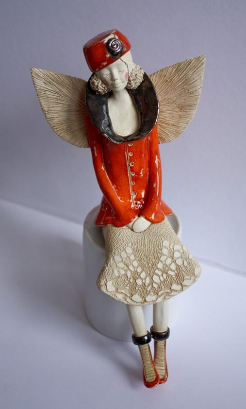 Anioł w oranżowym kubraczku